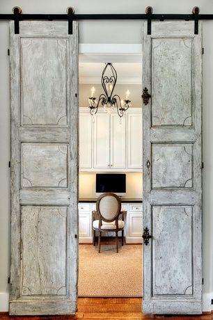 Traditional Home Office with Built-in bookshelf, Barn door, Hanging rustic door, Chandelier, Hardwood floors, Crown molding: