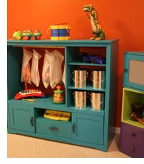 Entertainment center turned into shelf! Love the rod and the hanging bags of toys.