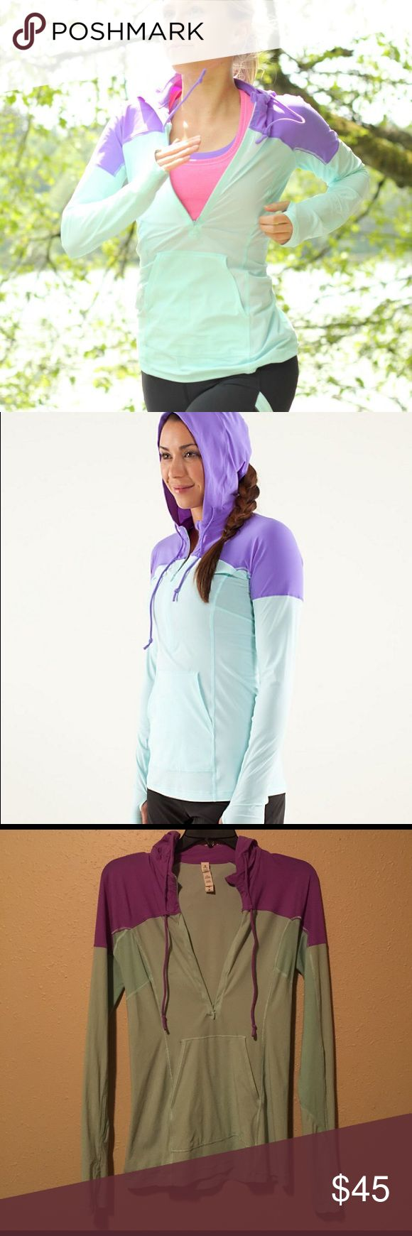 Lululemon Runbeam Hoodie Size 4 Lululemon Runbeam hoodie size 4. Aqua and purple color. Excellent condition, has a small dark spot on the chest (pictured). Just bought this and love it but don't have time to work out the small stain. Has thumbholes and a hole in the hood for your ponytail. Aquelu 4 way stretch fabric Offset seams under the arms help keep sensitive skin from chafing  Integrated drawcord system keeps them in place Flip up the sleeve to show reflective detailing kangaroo pocket…