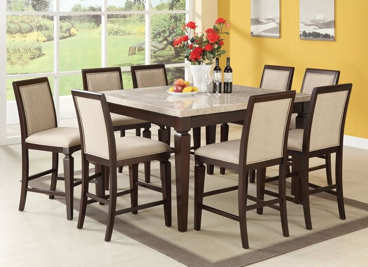 """7 pc Agatha collection Espresso finish wood white marble top counter height dining table set with linen fabric padded seats, This set features an espresso finish wood dining counter height dining table set with linen fabric upholstered padded seats. Table measures 54"""" x 54"""" x 36"""" H (rounded sides) ,side chairs (24"""" seat height). Some assembly required."""