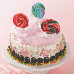 circus cake ~ super cute ~ taste of home ~ uses white frosting base, and from base of cake up: multi colored nerds, mini oreos, pink & white iced animal crackers, mini marshmallows and fluffy pink cotton candy on top ~ finish with colorful lollipops = adorable!