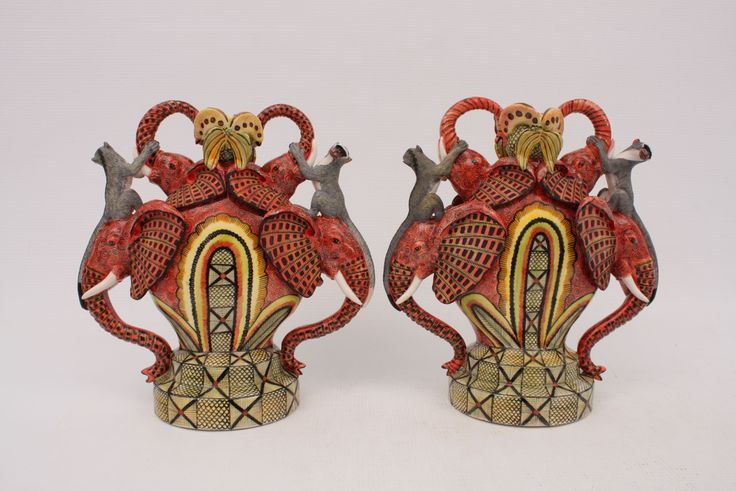 Two beautiful, red Elephant Candle Holders made by Moshe Sello and painted in fine detail by Jabu Nene.