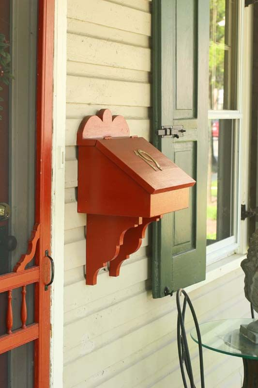 Wooden mailbox fits right in on this older home.