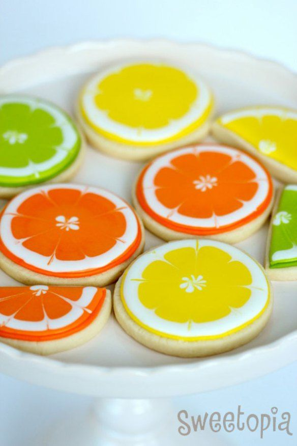 Citrus Cookie Tutorial from Sweetopia      IMG_3298-590x885    Tutorial & beautiful images thanks to Sweetopia! Check out Sweetopia for more great tutorials and decorating ideas!    out You Will Need:  - No Fail Sugar Cookie Recipe or Lemon Cookie Recipe found below  - Royal Icing Mix  - Round Cookie Cutter Set of 11  - Piping bags or squeeze bottles  - Couplers  - # 3 and #6 piping tips if using piping bag  - Electric Orange, Yellow a