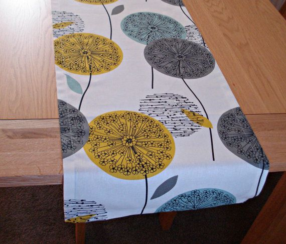 Gorgeous teal mustard yellow dandelion blue grey gray black clock allium design table runner    16 wide length 48 long.    Can be made in all sizes.
