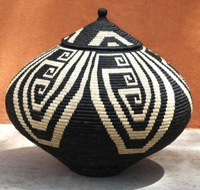 """""""Friendship"""" basket ( in detail with ebony whale ornament below left), a creel-style handbag, made by Jose Formoso Reyes in the 1950s."""