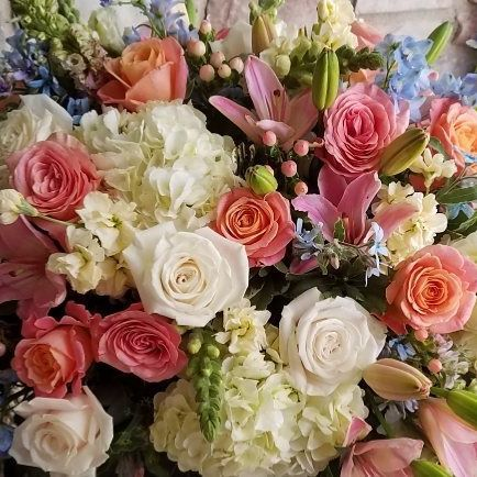 """Our motto here at Simply Flower is """"Flowers not Fillers"""" and we stay true to our brand. Never will you find sparsely arranged flowers amongst a sea of fillers. Our designs are chalk full of beautiful fresh blooms, ensuring a memorable end result."""