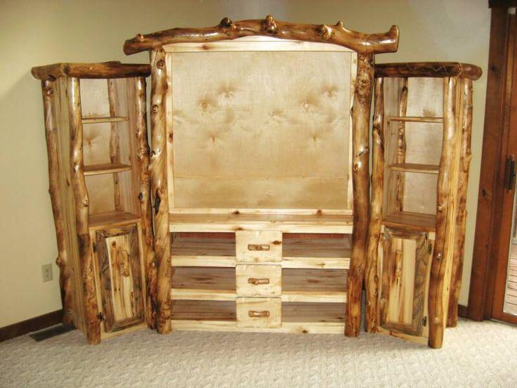 Entertainment centers custom log entertainment center for Log cabin furniture store