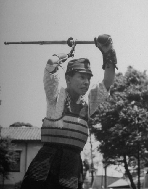 A Japanese veteran of the New Guinea campaign practicing Kendo with an artificial limb, during rehabilitation, 1944.