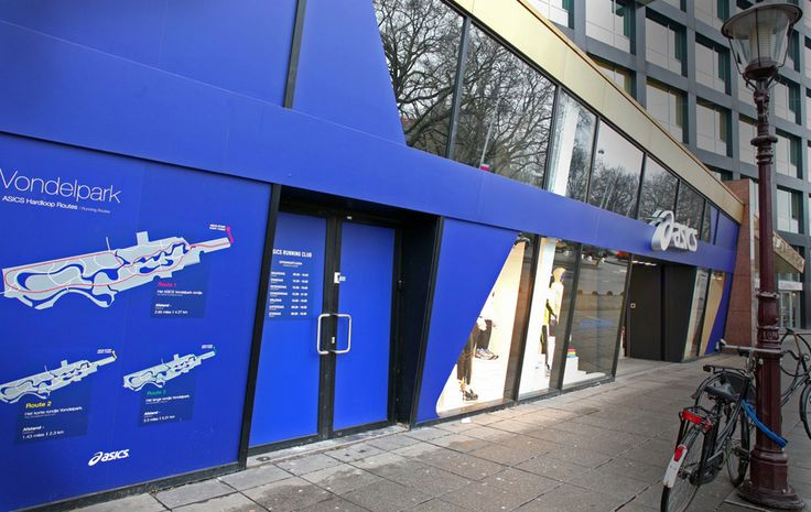 Asics Europe Asics flagship retail outlets based in Amsterdam, London and Barcelona. Following projects included: Exterior grade silver hoarding applied to both glazing and metallic fascia in Amsterdam. All interior graphics, consisting of matte, silver and suede wallpapers, optically clear vinyls and Wallapeel™. Permanent exterior graphics that are pantone matched blue from both inside and out.