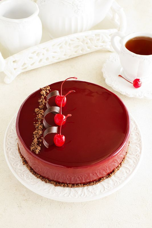Chocolate cherry cake covered with a mirror coating.: