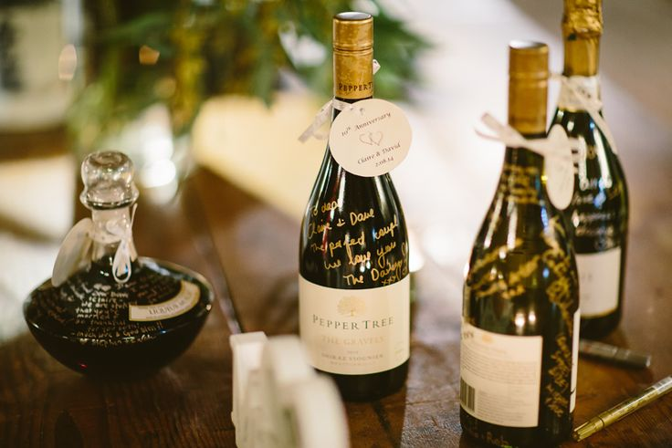 Wedding signing book alternative. Wine bottles for anniversaries that your guests leave messages on.  Image: Cavanagh Photography http://cavanaghphotography.com.au