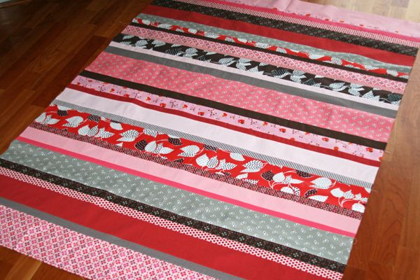 strip quilt- much easier than a traditional quilt, and super cute!