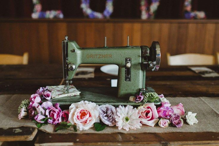 Bridal table eclectic sewing machine with flowers.