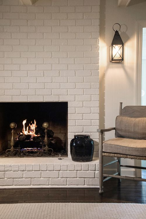 fireplace, painted brick, wall sconce  Jay Adkins for ...