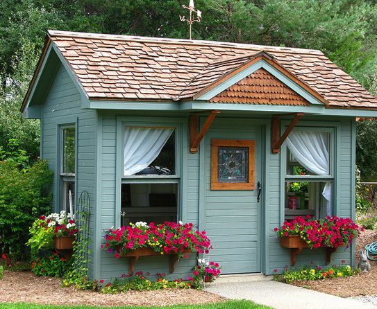 You can use wood pallets to build a potting shed in your garden. Use country colors like blue, aqua green and soft yellow for the material.