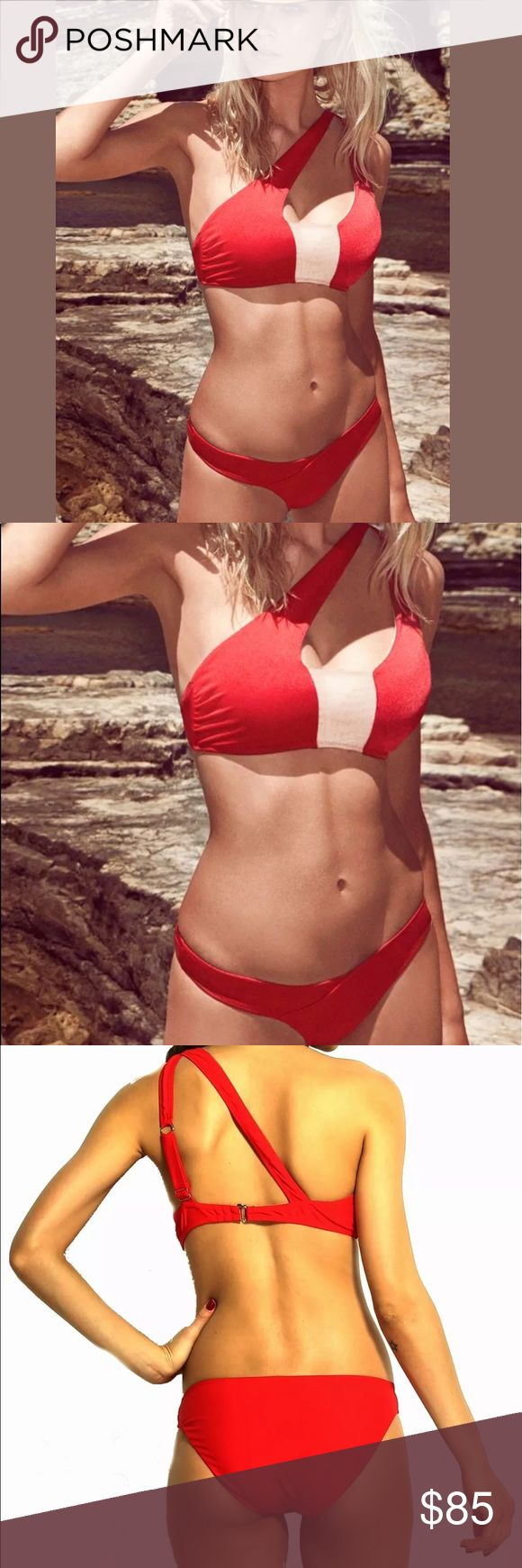 ¥firebird¥ Asymmetric Bandeau Red Bikini Just in! • ¥firebird¥ Fire on Fiji • Asymmetric Red Bikini • Bandeau top with adjustable asymmetrical one shoulder straps. Contrasting Block panel. Low rise cut detailed bottom. Breathable and durable nylon + spandex. Brand new/untagged. Only one Small and One medium. Swim Bikinis