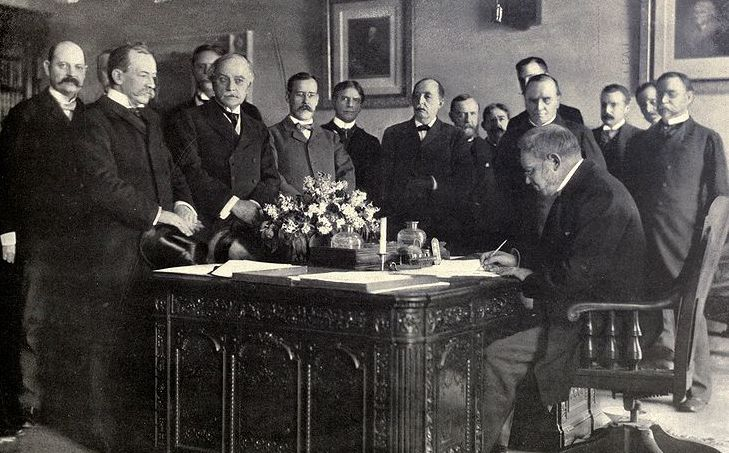 Jules Cambon, the French Ambassador to the United States, signing the memorandum of ratification on behalf of Spain (Photo credit: Wikipedia Commons).  A new era for Filipinos dawned on December 10, 1898 with the signing of the Treaty of Paris through which Spain ceded the Philippines, its colony for over 300 years, to the United States for US$ 20 million. The Peace Commission consisting of American and Spanish delegates met in Paris from October to December that year to discuss the terms…