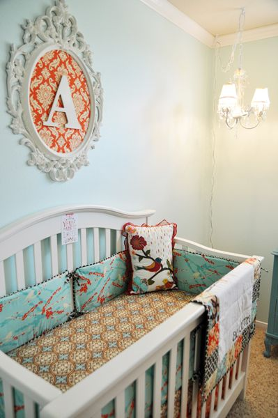 Gender Neutral Nursery - Vintage Baby Room. Love the orange dresser and all the birdies! // I don't know how gender neutral the paisly and flourishes are - but I love it none-the-less