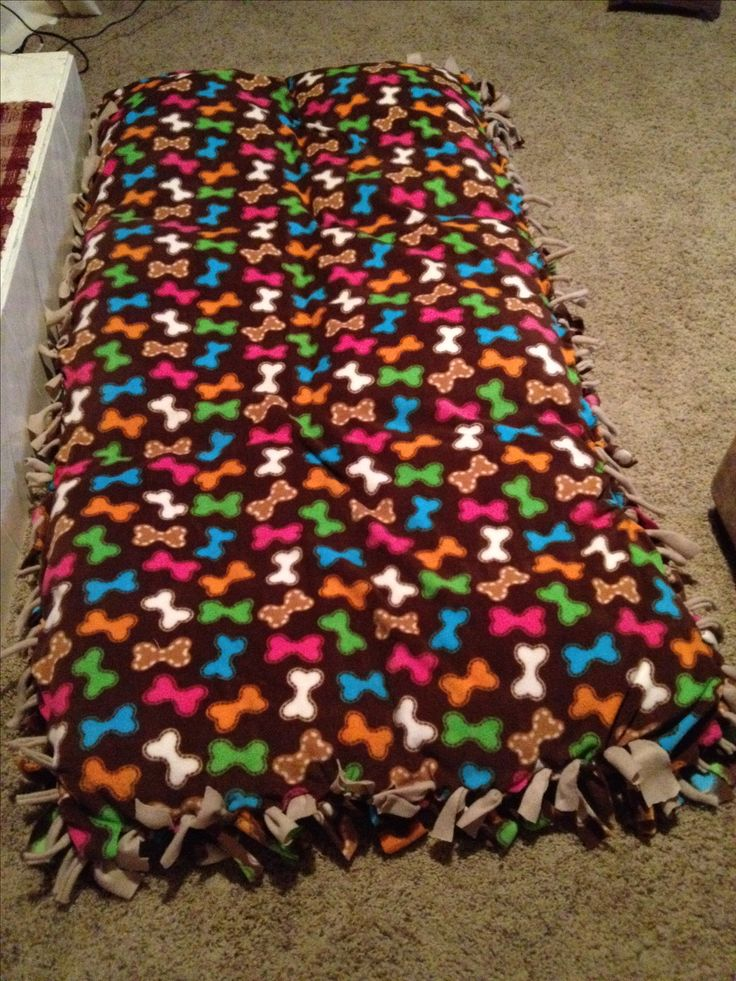 DIY dog bed for less! I'm too tight to spend $60 for a large dog bed, especially needing two for our dogs so I made one for both and a lot less! I took 6 pillows and stitched them together, covered them with 3 yards of fleece fabric (one a printed fabric and just a plain fabric- 6 yards total) and cut then tied. Total cost was $15 for pillows, $9 for plain fleece & $27 (yikes) for printed fabric = $51 compared to $120. The size of this dog bed is huge, about the length and width of a…