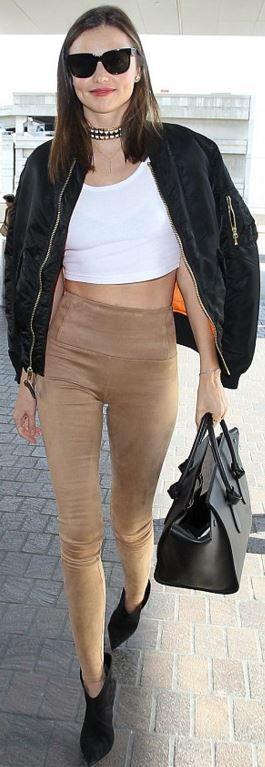 Miranda Kerr: Sunglasses – Chanel  Pants – Aritzia  Purse – Celine  Shoes – Saint Laurent  Coat – Unravel