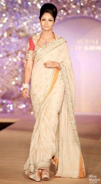 Cream and red sari. Abu Jani and Sandeep Khosla presents The Golden Peacock Collection.