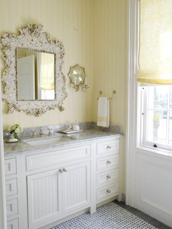 Gallery For Photographers bedrooms yellow tone on tone wallpaper yellow linen roman shade white single bathroom vanity white carrara marble top beadboard doors marble basketweave