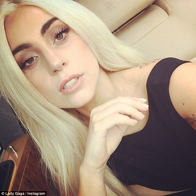 Lady Gaga sports shockingly normal look in demure figure-sculpting ...