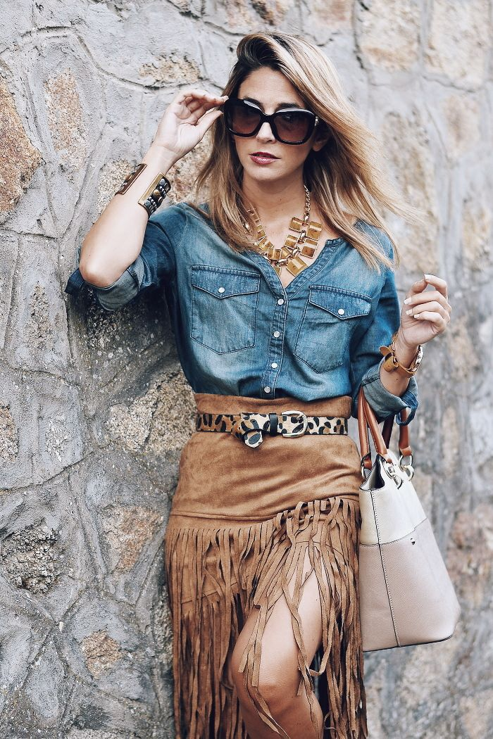 spring / summer - street style - street chic style - summer outfits - fall outfits - party outfits - denim shirt + brown suede fringe skirt + black sunglasses + nude handbag + leopard print belt + brown strappy heeled sandals + statement necklace