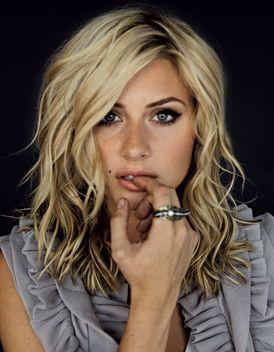Medium, wavy, blonde hair.