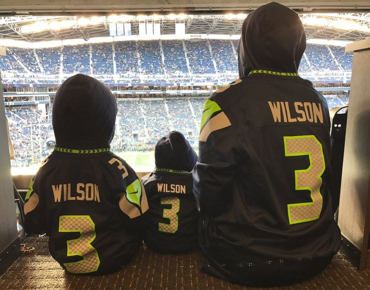 Ciara Wilson, Future, and baby Sienna supporting Russell Wilson