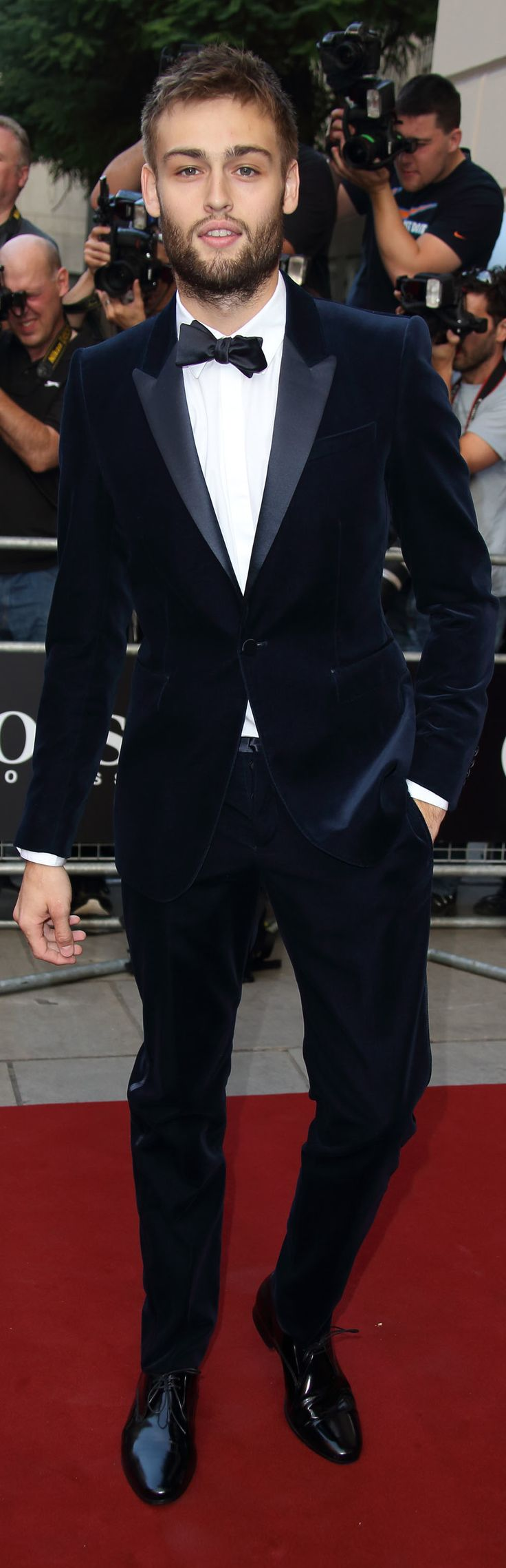 British actor Douglas Booth wearing Burberry tailoring to the GQ Men of the Year Awards in London