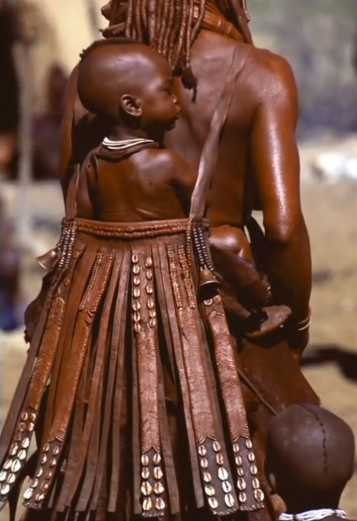 Africa | The beautiful baby carrier's of the Himba.  Namibia.  | ©Carol Beckwith  Angela Fisher.
