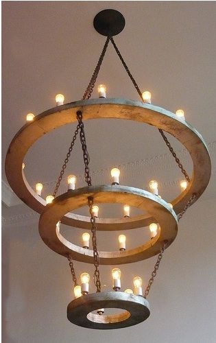modern halo chandelier - edgy and innovative - never seen one like it- love the bulbs and on iron circles - lighting to remember