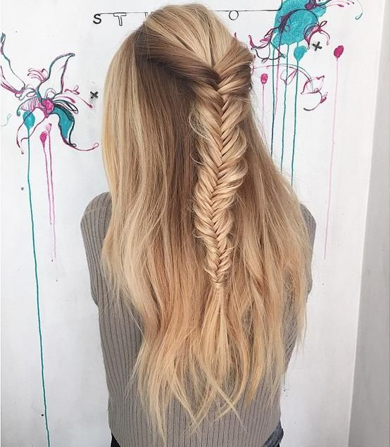 Take a section of hair and fishtail it, then pull the strands to make it look fuller.