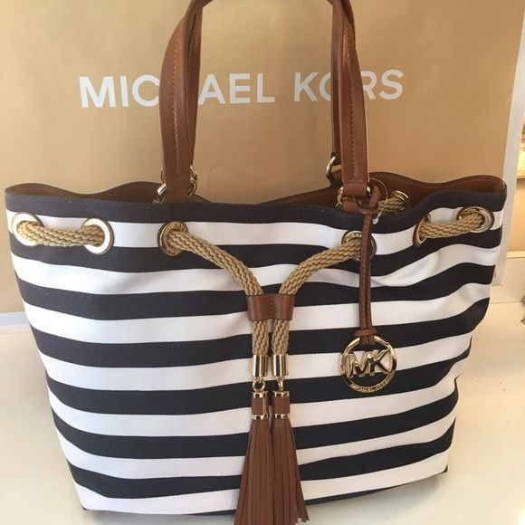MICHAEL KORS NEW  NAUTICAL SHOULDER BAG AUTHENTIC MICHAEL KORS NEW AND NEVER USED WITH TAGS  NAUTICAL SHOULDER BAG.  THIS IS SUCH A AMAZING AND PERFECT BAG.  SO STYLISH IN EVERY WAY WITH ALL OF ITS AMAZING HARDWARE . THIS BAG MEASURES 17. INCHES WIDE BY 11. INCHES TALL AND A 9. INCH DEOP ON THE HANDLE Michael Kors Bags Shoulder Bags