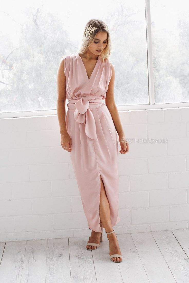 The Athens Blush Maxi Dress features a wrap over maxi dress shape suits all figures, and a pretty tulip hemline is cut to show off embellished sandals or strappy heels. Pleated effects and an elasticated waistband streamline the contours.fit: standard sizing, relaxed fit, medium weight fabric, un...