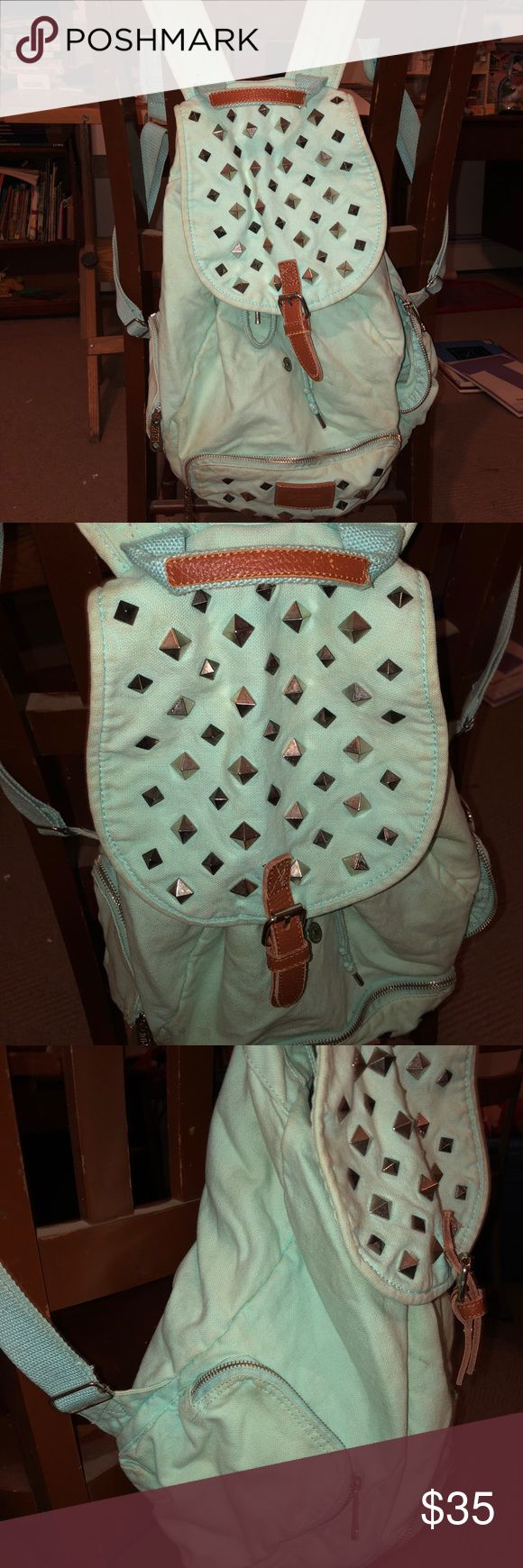 "Victoria's Secret ""pink"" mint backpack Mint/Studded silver backpack. Pink by Victoria's Secret. Good condition just missing the magnet that clips the bag together.(last picture) PINK Victoria's Secret Bags Backpacks"