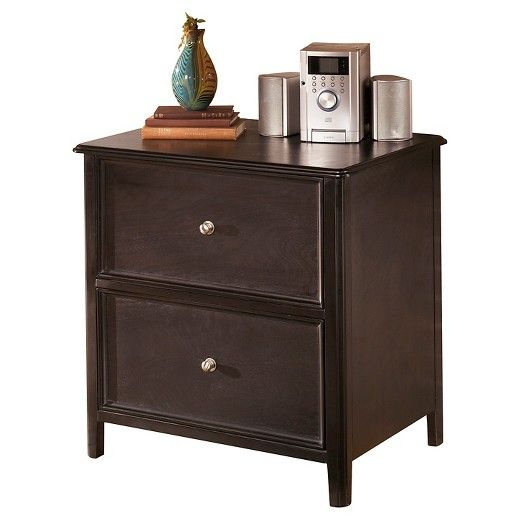 Organize and file in chic, modern style with this lateral file cabinet. Bathed in a rich finish—with lovely tapered details and inlaid panels for a softening effect—it's simple yet quite sophisticated. Signature Design by Ashley is a registered trademark of Ashley Furniture Industries, Inc.