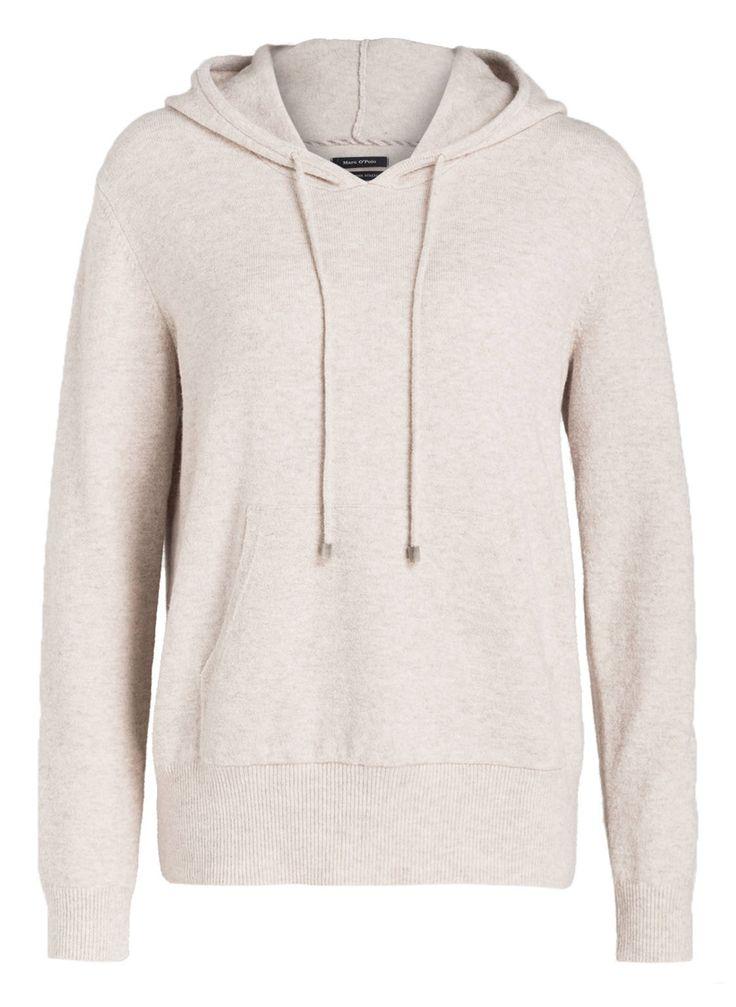 Das Sweatshirt aus feinem Strick für Damen von Marc O'Polo ist die perfekte Wahl für entspannte Stunden daheim! Es bietet Ihnen einen kuscheligen Komfort und lädt wahrlich zum Wohlfühlen ein. Sportive Akzente setzen die Kapuze mit Tunnelzug und die Kängurutasche vorn. Auch als Casual-Basic in Kombination mit Jeans und Sneakern macht das Modell eine gute Figur!Details:Gerader SchnittKapuze mit TunnelzugRippbündchen an Ärmeln und SaumKängurutascheWeiche HaptikKuscheliger Komfort Maße bei Größe…