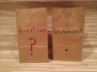 Put small items in each bag. Children have to say either a question or statement for the item they take out.