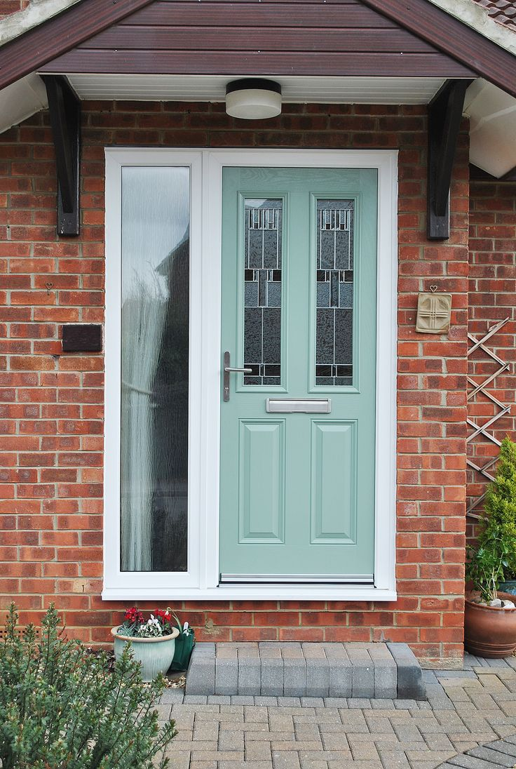 We Love this recent installation. Over the years we have seen a increase in wonderful de-saturated greens, greys and blues symbolic of a vintage, shabby chic vibe. Here we have a stunning chartwell green composite front door, with altmore two panel Door design and zinc prairie glass, with a side panel for optimal light. The Rest of the house was installed with fantastic simple Rehau UPVC profile windows.