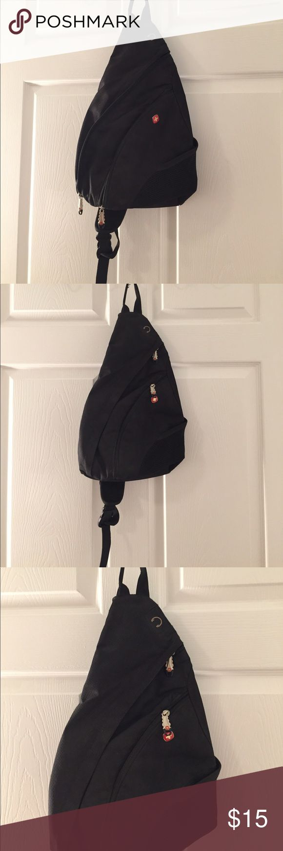 SwissGear by Wenger one strap back pack Swiss Gear by Wenger one strap backpack in black. Barely used and like new! Great for biking, hiking, or any on the go activity. Has several zippered compartments and adjustable strap. Lightweight and unisex. ✨Bundles of 3+ items get 15% off! SwissGear Bags Backpacks