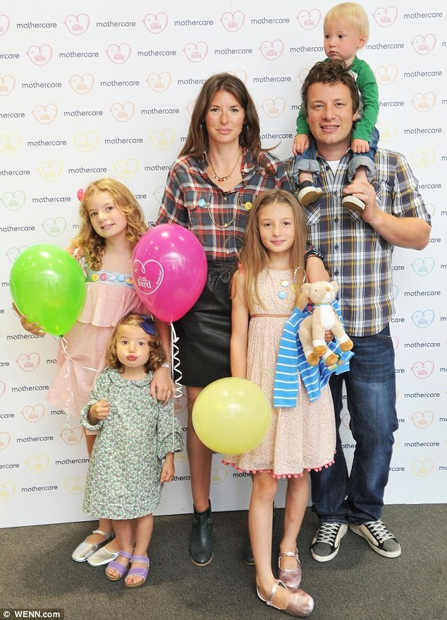 Jools and Jamie with their children Poppy, Daisy, Petal and Buddy at the launch of Little Bird for Mothercare / I love this family.. Jamie is just..the best.