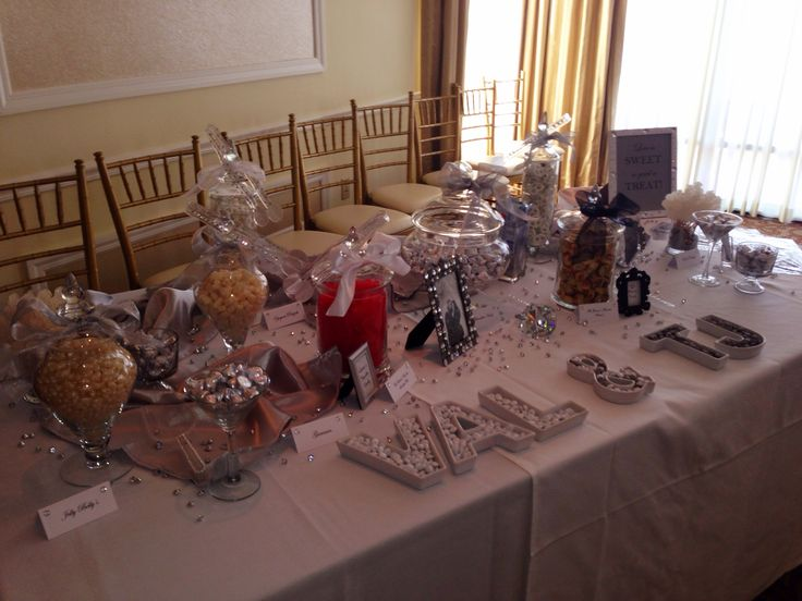 Gray and white candy table for a bridal shower. Also added the bride and grooms favorite candy. Used the bride and grooms names for candy dishes for an extra touch