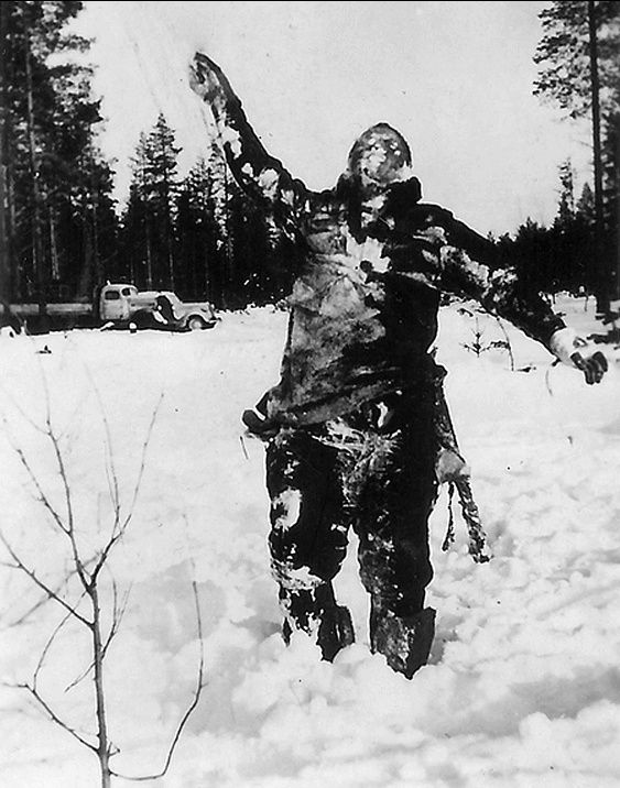 Finnish soldiers- stood dead Russian soldiers up to intimidate further attackers, Finland, Winter War 1939. Gory, but historically interesting.