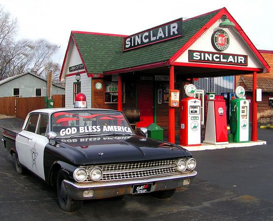 It's not a truck but it fits the vintage theme. Antique Ford police car outside the restored Sinclair Gas Station in Bucyrus, Ohio.