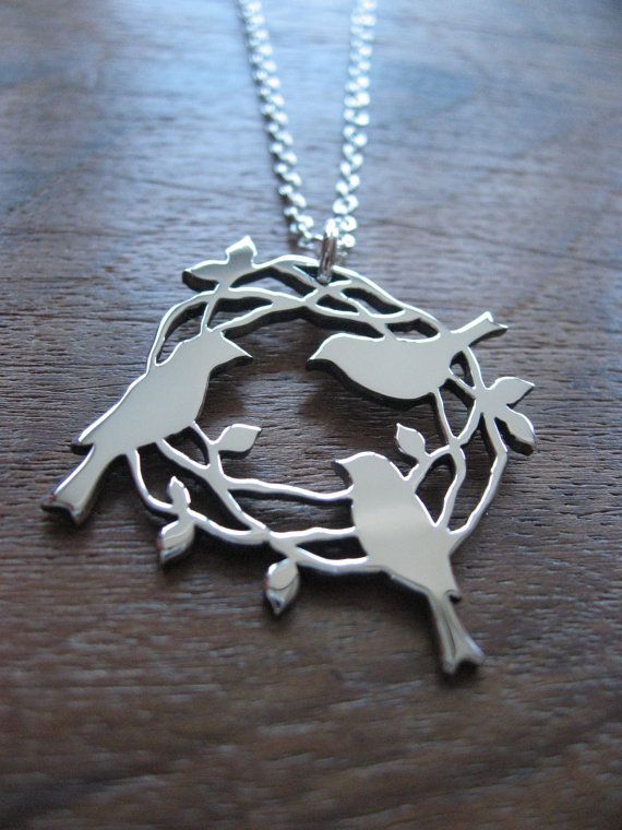 A hand cut pendant, three birds sitting on a nest. The pendant is 1.2mm thick and roughly 3cm across, it is made from Argentium silver, a very high quality sterling silver. It will come on an 18 Sterling silver chain, if youd like a 16 or 20 chain please leave a note during purchase. If youd like a chain longer than 20 please message me before buying so that I can adjust the cost. PLEASE NOTE - I typically make these designs once the order has taken place, so if you have a deadline let me…