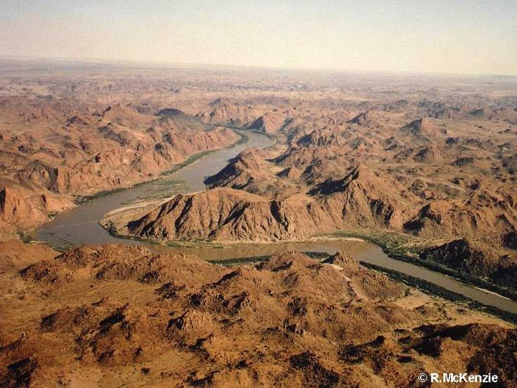 Stunning Richtersveld mountain scenery which is cleaved by the passage of the Orange River.