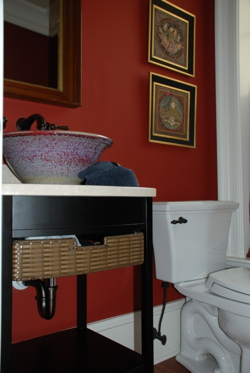 nice pairing of red/bright color with interesting sink basin, white counter for bathroom